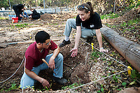 Forensics Anthropologist and Assistant Professor Lori Baker, PhD., instructs senior Forensic Science major Nathan Trevino (cq) how to properly exhume a skeleton from a grave during her Death, Injury, and Physical Remains class at Baylor University in Waco, Texas, Tuesday, Nov., 10, 2009. Dr. Baker, who began a DNA missing person database with the Mexican Consul to help with identifications, makes a point to teach future forensic scientists about migrant death issues...PHOTO/ MATT NAGER