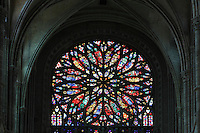 South rose window of the transept, whose design reflects flickering flames, 16th century, in the Basilique Cathedrale Notre-Dame d'Amiens or Cathedral Basilica of Our Lady of Amiens, built 1220-70 in Gothic style, Amiens, Picardy, France. Amiens Cathedral was listed as a UNESCO World Heritage Site in 1981. Picture by Manuel Cohen