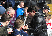 Lincoln City manager Danny Cowley signs autographs during the pre-match warm-up<br /> <br /> Photographer Andrew Vaughan/CameraSport<br /> <br /> The EFL Sky Bet League Two - Lincoln City v Cheltenham Town - Saturday 13th April 2019 - Sincil Bank - Lincoln<br /> <br /> World Copyright &copy; 2019 CameraSport. All rights reserved. 43 Linden Ave. Countesthorpe. Leicester. England. LE8 5PG - Tel: +44 (0) 116 277 4147 - admin@camerasport.com - www.camerasport.com