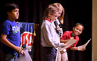 NWA Democrat-Gazette/DAVID GOTTSCHALK Kamaile Zackious (right), a third grade student a LISA Academy Springdale, checks on her school mates Violet Pride, a fifth grade student, Clara Pride, third grade student, and Emmanual Gonzalez, a fourth grade student, before they sing the National Anthem Tuesday, November 5, 2019, during a ribbon cutting ceremony celebrating the opening of the Springdale campus. The building, formerly Ozark Montessori Academy, transitioned to LISA Academy at the beginning of this school year. The school serves 230 students, grades kindergarten through eighth.