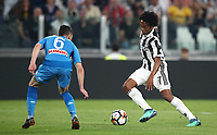 Calcio, Serie A: Juventus - Napoli, Torino, Allianz Stadium, 22 aprile, 2018.<br /> Juventus Juan Cuadrado (r) in action with Napoli's Mario Rui (l) during the Italian Serie A football match between Juventus and Napoli at Torino's Allianz stadium, April 22, 2018.<br /> UPDATE IMAGES PRESS/Isabella Bonotto