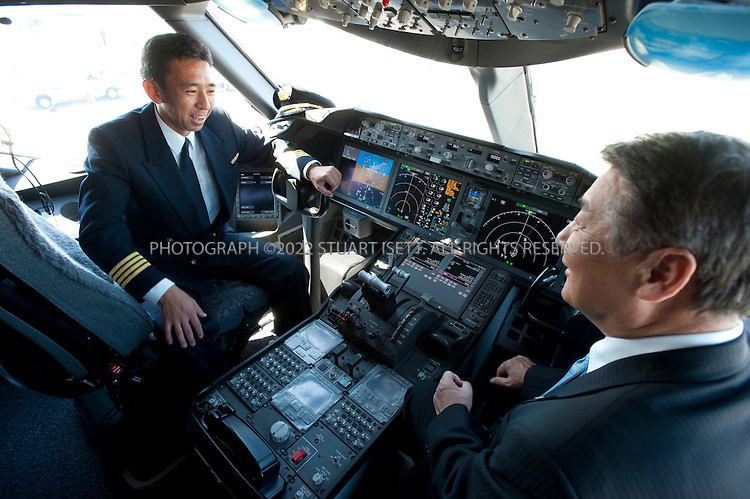 8/8/2011--Everett, WA, USA..ANA (All Nippon Airways) pilot Yoshio Taneda (left) and Mitsuo Morimoto (right), ANA's Executive Vice President Flight Operations, on the flight deck of the airline's first Boeing 787 Dreamliner...Boeing presented the first 787 Dreamliner to launch customer ANA (All Nippon Airways) at Paine Field in Everett, WASH., north of Seattle. The new planes's first commercial flight will be a special charter from Tokyo to Hong Kong...©2011 Stuart Isett. All rights reserved.