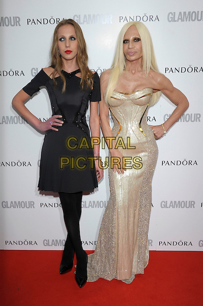 Allegra Versace, Donatella Versace.Women Of The Year 2012 - Glamour Awards, Berkeley Square, London, England..29th May 2012.full length gold strapless dress corset hand on hip tights black daughter mother mom mum family .CAP/PL.©Phil Loftus/Capital Pictures.