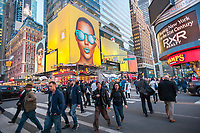 "A billboard in Times Square in New York advertises Snap's Spectacles, a camera-sunglasses hybrid, on Tuesday, March 21, 2017. Snap, the owner of Snapchat and the Spectacles product, has seen its shares finally rise after their IPO after receiving two ""buy"" ratings from Wall Street analysts.   (© Richard B. Levine)"