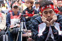 A man dozes as he listens to speeches during a rally by l eft wing and unionists hold at the open air stage in Hibuya Park, Tokyo, Japan. Sunday November 3rd  2013