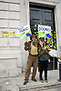 Put it to the People demonstration in central London against Brexit and an appeal for a Peoples Vote on a final Deal. Homage to Dad's Army in front of Cabinet Office entrance covered with stickers. London UK 23 March 2019