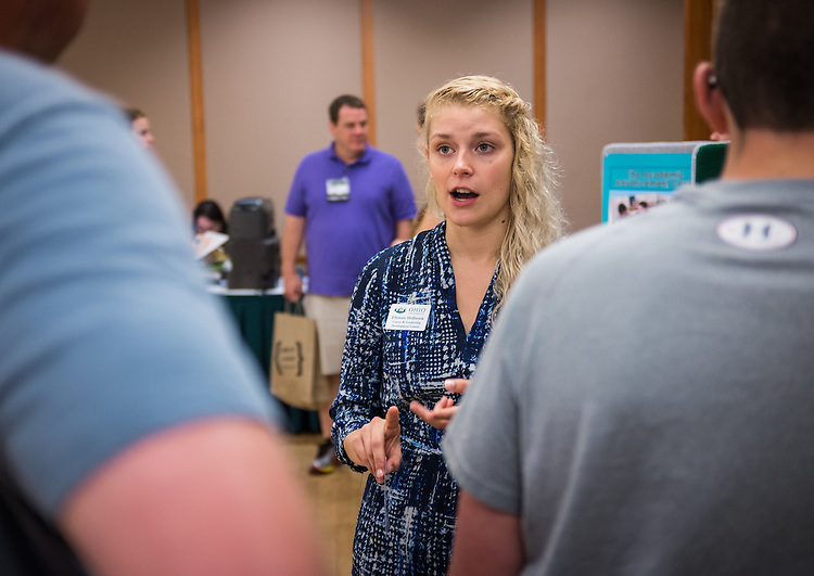 Ellenore Holbrook discusses the offerings of the Career and Leadership Development Center with new Bobcats and their parents during the sign-in for  Bobcat Student Orientation on Friday, June 5, 2015.  Photo by Ohio University  /  Rob Hardin