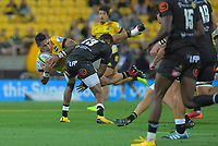 Alex Fidow (Hurricanes) is tackled during the Super Rugby match between the Hurricanes and Sharks at Sky Stadium in Wellington, New Zealand on Saturday, 15 February 2020. Photo: Dave Lintott / lintottphoto.co.nz