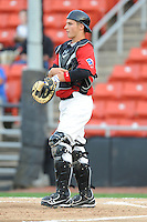 Hickory Crawdads Kellin Deglan #15 takes a break during a game vs. the Hickory Crawdads at L.P. Franz Stadium in Hickory,  North Carolina;  April 7, 2011.  Hickory defeated Asheville 4-2.  Photo By Tony Farlow/Four Seam Images