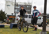 "Dunning Hancock, 12, of Bentonville (center) rides as coach Ben Tufford (right) observes, Monday, March 23, 2020 at Compton Gardens in Bentonville Check out nwaonline.com/200323Daily/ for today's photo gallery.<br /> (NWA Democrat-Gazette/Charlie Kaijo)<br /> <br /> Cognition Endurance Sports Coaching held a mountain bike day camp for boys and girls age 10 to 14. The camp was supposed to be a five-day camp but was cut short due to concerns about the corona virus. ""My hope is we can do this again in the summer and things will be a lot different then,"" said Ben Tufford of Cognition Endurance Sports Coaching."