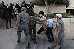 Ultra Orthodox Jews clash with Israeli police forces during the weekly demonstrations against the Jerusalem's municipality's decision to open one of the parking lots in the city on Sabbath, Jerusalem, July 11, 2009. This is the third week in a row in which the Ultra-Orthodox Jews of Jerusalem have flocked in their thousands to the streets and continue clashes with police and members of the press. Photo By : Maya Levin / JINI