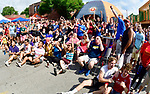 Soccer fans outside the Amsterdam Tavern in St. Louis react to a second half goal by France while watching the broadcast of the World Cup soccer championship game between Croatia and France on Sunday July 15, 2018.               Photo by Tim Vizer