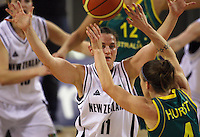 Tall Ferns guard Kate McMeeken-Ruscoe tries to block the pass of Natalie Hurst during the International women's basketball match between NZ Tall Ferns and Australian Opals at Te Rauparaha Stadium, Porirua, Wellington, New Zealand on Monday 31 August 2009. Photo: Dave Lintott / lintottphoto.co.nz