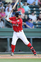 Nick Longhi (21) of the Greenville Drive bats in a game against the Rome Braves on Friday, June 12, 2015, at Fluor Field at the West End in Greenville, South Carolina. Longhi is the No. 27 prospect of the Boston Red Sox, according to Baseball America. (Tom Priddy/Four Seam Images)