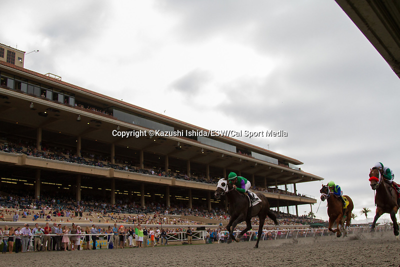 AUG 13,2014:Merit Man,ridden by Kent Desormeaux(green cap),wins the Green Flash Handicap at Del Mar in Del Mar,CA. Kazushi Ishida/ESW/CSM