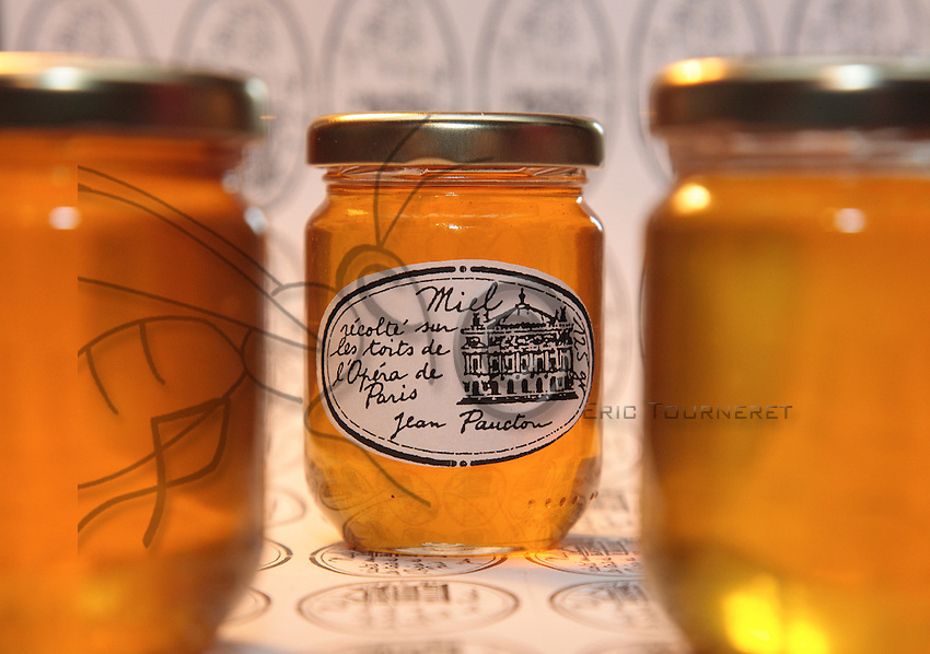 """A jar of honey from the Opera garnier. """"When I went up onto the roof one week after setting up my first hive, it was a veritable honey house,"""" remembers Jean Paucton. """"Honey was dripping everywhere! It was a very flavorful honey, with notes of lemon and mint. This is not at all an ordinary honey, like that from rape or sunflower""""."""