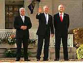 President George W. Bush waves  with Israeli Prime Minister Ehud Olmert on right and Palestinian Authority President Mahmoud Abbas on left, at the .Middle East Peace Conference  at the U. S Naval Academy in Annapolis, Maryland on November 27, 2007.Agency pool photo by Dennis Brack/Black Star