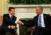 United States President Barack Obama, right, and President Enrique Peña Nieto of Mexico, left, shake hands as they conclude their remarks to the media following their meeting in the Oval Office of the White House in Washington, D.C. on Tuesday, January 6, 2015.<br /> Credit: Dennis Brack / Pool via CNP