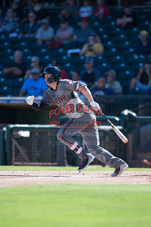 Salt River Rafters designated hitter Drew Ellis (13), of the Arizona Diamondbacks organization, starts down the first base line during an Arizona Fall League game against the Surprise Saguaros on October 9, 2018 at Surprise Stadium in Surprise, Arizona. The Rafters defeated the Saguaros 10-8. (Zachary Lucy/Four Seam Images)