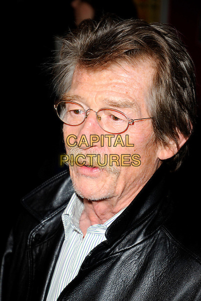 "JOHN HURT .At the UK Film Premiere of ""Happy-Go-Lucky"" held at the Odeon Leicester Square, London, England, .April 14th 2008..Happy Go Lucky portrait headshot  moustache glasses .CAP/CAN.©Can Nguyen/Capital Pictures"