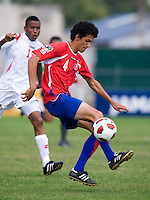 David Acuna (4) of Costa Rica takes a touch on the ball during the quarterfinals of the CONCACAF Men's Under 17 Championship at Catherine Hall Stadium in Montego Bay, Jamaica. Panama defeated Costa Rica, 1-0.