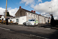 Tuesday 18 February 2014<br /> Pictured: A police car leaves the scene  at New Road Pontyberem<br /> Re:A dog has been seized by police following the sudden death of a baby in Carmarthenshire.Officers say they had a call alerting them to the incident at a property in New Road, Pontyberem, shortly before 08:30 GMT on Tuesday.The baby was airlifted to the University Hospital of Wales, Cardiff, the Welsh Ambulance Service said.The dog involved in the incident was an Alaskan Malamute, similar to a Husky, which is not a banned breed.
