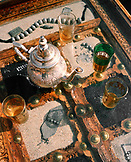 OMAN, Muscat, Barr Al Jissah Resort and Spa, silver teapot and glass tea cups on a table, close-up