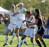 Katie Larkin (18) goes up for the ball above Stephanie Cox (14) and FC Gold Pride's Brandi Chastain (right). Los Angeles Sol defeated FC Gold Pride 2-0 at Buck Shaw Stadium in Santa Clara, California on May 24, 2009.