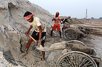 Workers dig sand on the grounds of a brick making factory on the outskirts of Kolkata.<br /> <br /> To license this image, please contact the National Geographic Creative Collection:<br /> <br /> Image ID: 1925842 <br />  <br /> Email: natgeocreative@ngs.org<br /> <br /> Telephone: 202 857 7537 / Toll Free 800 434 2244<br /> <br /> National Geographic Creative<br /> 1145 17th St NW, Washington DC 20036