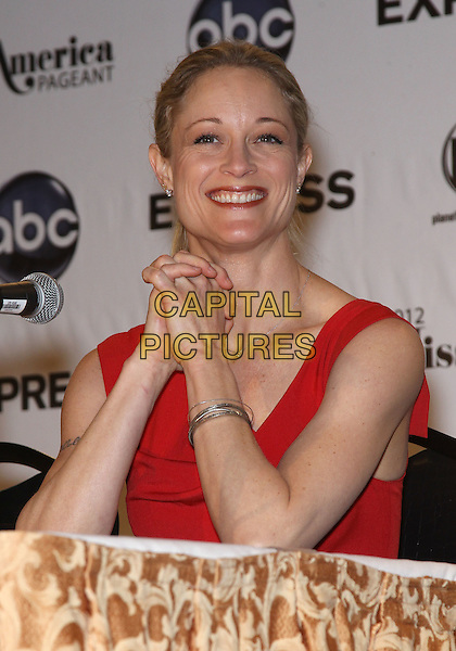 Teri Polo.2012 Miss America Judges Press Conference at the Planet Hollywood Resort Hotel and Casino, Las Vegas, Nevada, USA..January 11th, 2012 .half length red sleeveless hands together praying smiling.CAP/ADM/MJT.© MJT/AdMedia/Capital Pictures.