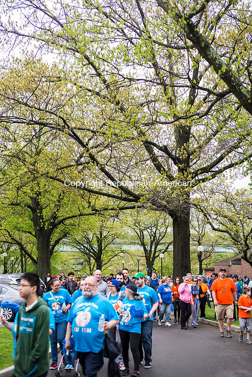 Waterbury, CT- 06 May 2017-050617CM03-  Supporters make their way through Library Park during the 8th annual Western Connecticut Autism Speaks Walk in Waterbury on Saturday.  Proceeds from the event will support Autism Speaks and for the needs of individuals with autism and their families.  Approximately 1200 supporters attended the event. Christopher Massa Republican-American