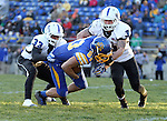 BROOKINGS, SD - NOVEMBER 9:  Jason Schneider #83 from South Dakota State University is brought down at the one yard line by Taje High #33 and Donovan Layne #3 from Indiana State University Saturday at Coughlin Alumni Stadium. (Photo by Dave Eggen/Inertia)