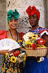 Street fair performers in traditional costumes, Havana, Cuba