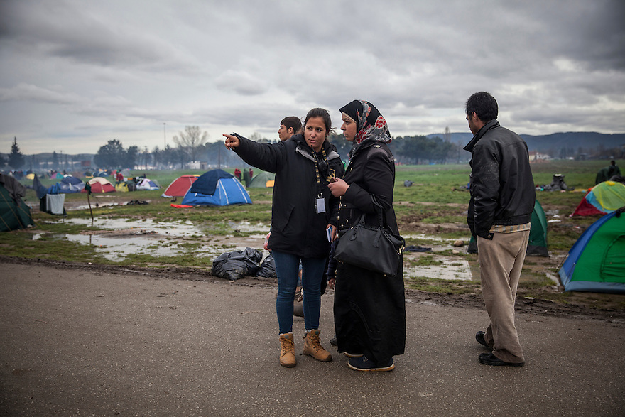 IDOMENI, GREECE-- March 10, 2016-- Mathilde Belli, member of the IRC protection team speaking with refugees at Idomeni border camp on the Macedonian border. PHOTO BY JODI HILTON FOR INTERNATIONAL RESCUE COMMITTEE
