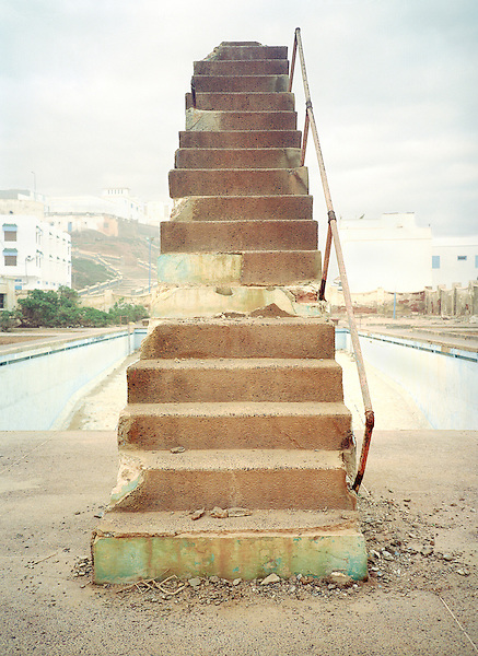 Steps to a decaying stone diving board. Abondoned public pool. Sidi Ifni , South West Coast of Morocco. North Africa