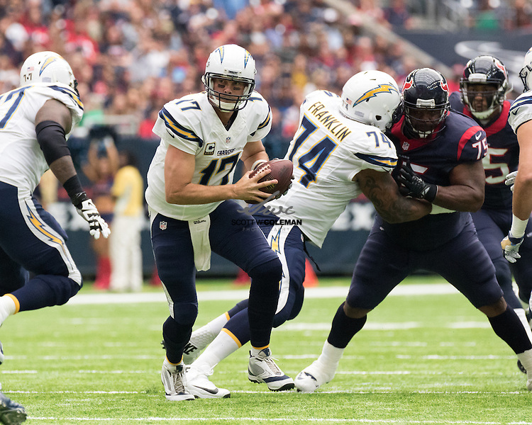 San Diego Chargers quarterback Philip Rivers (17) prepares to hand the ball off as San Diego Chargers offensive guard Orlando Franklin (74) blocks Houston Texans nose tackle Vince Wilfork (75) during the first half of an NFL football game between the Houston Texans and the San Diego Chargers at NRG Stadium in Houston, Texas. The Chargers won 21-13.