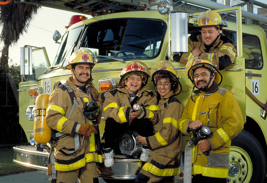 FAMILY OF HISPANIC FIREFIGHTERS PORTRAIT. HISPANIC FIREFIGHTERS. SAN JOSE CALIFORNIA.
