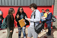 NWA Democrat-Gazette/DAVID GOTTSCHALK Martina Berti (from left), a junior from Harrison High School, Ava Marie Velasquez, a freshman and Brooks Burnside, a freshman, discuss the requirement packet Wednesday, October 10, 2019, during day one of the 9th Annual Ozark Media Arts Festival in downtown Springdale. High School students from more than 45 media programs in Arkansas are participating in the two day event that showcases video and photography and offers industry led workshops, onsite competitions, and a network to education and industry.