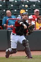 Erie Seawolves catcher Craig Albernaz (1) throws to first during a game against the Binghamton Mets on July 13, 2014 at Jerry Uht Park in Erie, Pennsylvania.  Binghamton defeated Erie 5-4.  (Mike Janes/Four Seam Images)