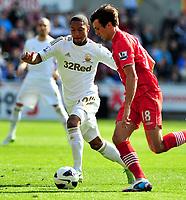 Pictured: Swansea's Jonathan De Guzman (L) chasing possession.<br /> Saturday 20 April 2013<br /> Re: Barclay's Premier League, Swansea City FC v Southampton at the Liberty Stadium, south Wales.