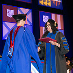 Salma Ghanem, dean of the College of Communication, congratulates students Sunday, June 11, 2017, during the DePaul University College of Computing and Digital Media and the College of Communication commencement ceremony at the Allstate Arena in Rosemont, IL. (DePaul University/Jamie Moncrief)