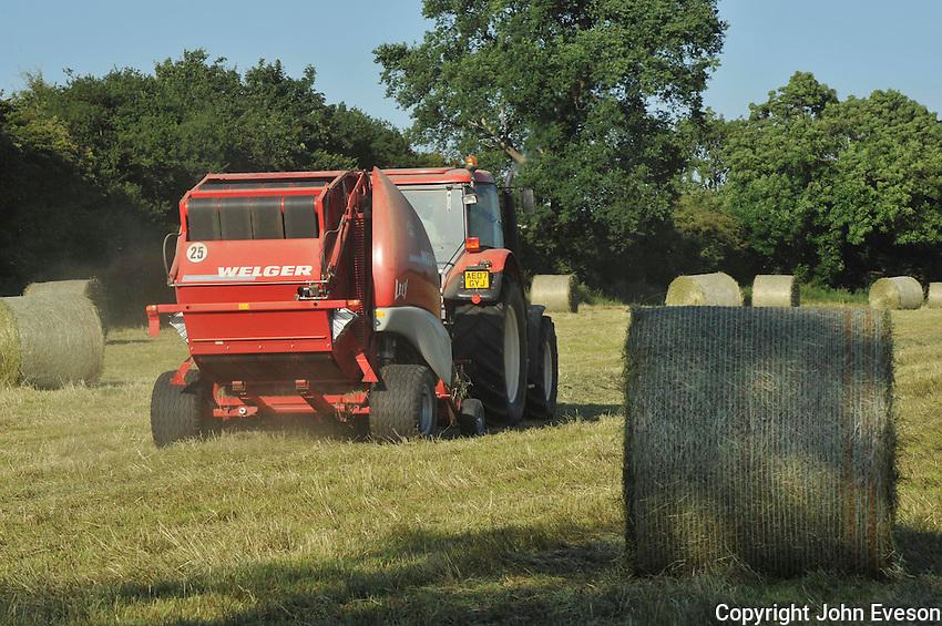 Big baling hay, Lincolnshire.......Copyright..John Eveson, Dinkling Green Farm, Whitewell, Clitheroe, Lancashire. BB7 3BN.01995 61280. 07973 482705.j.r.eveson@btinternet.com.www.johneveson.com