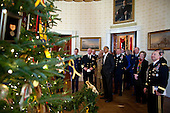United States President Barack Obama shows military officials the White House Christmas Tree in the Blue Room following a meeting, Dec. 1, 2011. The 18-foot-6 inch balsam fir was decorated with holiday cards created by military children and ornaments featuring medals, badges, and patches from all of the military branches..Mandatory Credit: Pete Souza - White House via CNP