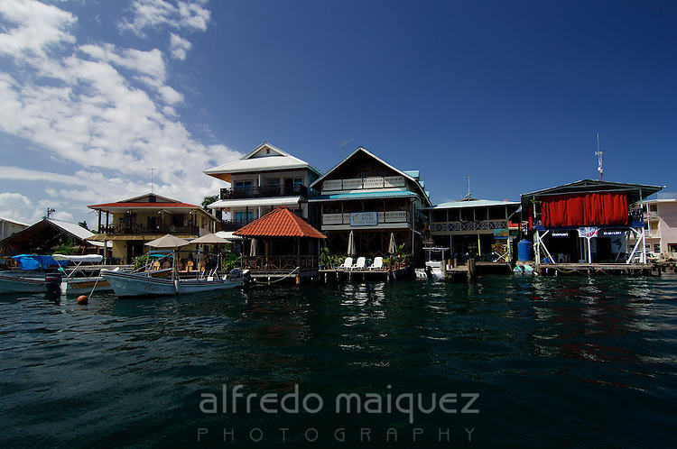 Motor boats moored at docks of sea side hotels. Colon Island, Bocas del Toro, Panama, Caribbean, Central America.