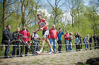 Kenny Dehaes (BEL/Lotto-Belisol) punctured halfway down the Trouée d'Arenberg / Bois de Wallers-Arenberg, which left him stranded for minutes before help arrived and robbed him of any chance regaining the breakaway he was in<br /> <br /> Paris - Roubaux 2014
