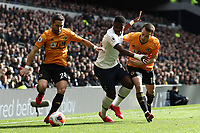 1st March 2020; Tottenham Hotspur Stadium, London, England; English Premier League Football, Tottenham Hotspur versus Wolverhampton Wanderers; Serge Aurier of Tottenham Hotspur competes for the ball with João Moutinho and Diogo Jota of Wolverhampton Wanderers