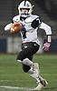 Nicholas Turrini #7, Calhoun quarterback, scrambles for a gain during the Nassau County Conference II varsity football semifinals against Garden City at Hofstra University on Friday, Nov. 10, 2017.