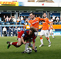 Fred Murray of Luton tackles Chris Carruthers of York City during the Blue Square Premier play-off semi-final 2nd leg  match between Luton Town and York City at Kenilworth Road, Luton on Monday 3rd May, 2010..© Kevin Coleman 2010 ..