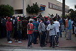 Dozens of sub-saharan immigrants waiting at the door of the Police Headquarters in Melilla for the delivery of a stay card in the CETI - Temporary Centre for Immigrants -. The city of Melilla is a Spanish city separated from the rest of Africa permanently guarded by a fence..