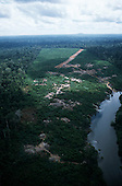 Ipixuna, Amazon, Brazil. Aerial view of the village and the river with the airstrip beyond; Arawete Indians.